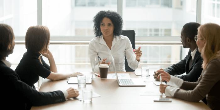 Female Company Leader hosting meeting