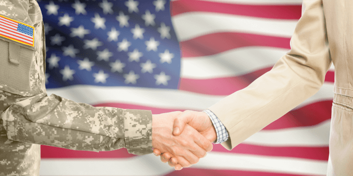 veteran shaking hands with business person