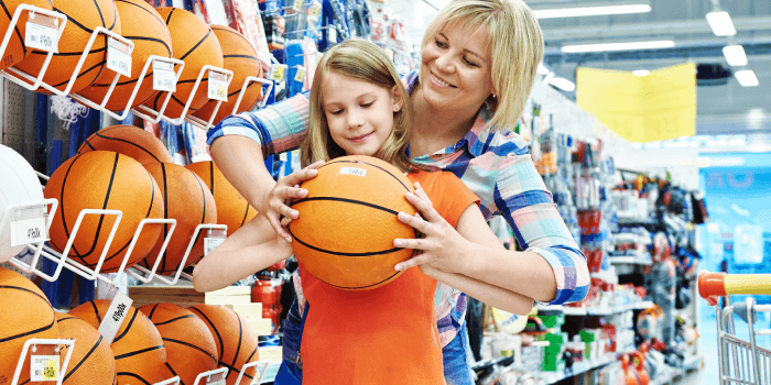 Girl and mother buying sporting good supplies